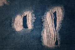 Texture background jeans with holes close up. In dark style Royalty Free Stock Photography