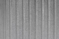 Texture for background metal profiled fence. A corrugated fence of grey metal sheets royalty free stock photo