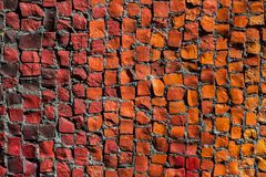 Texture background of mosaic multi colored stones on the wall. stock photo