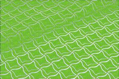 Texture, background, pattern. Abstraction. Green embossed background. Rhombuses of white color. Computer drawing stock photo