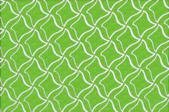 Texture, background, pattern. Abstraction. Green embossed background. Rhombuses of white color. Computer drawing royalty free stock photo