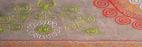 Texture, background, pattern. Cloth of cotton with embroidery of