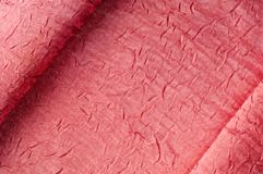 Texture, background, pattern. Cloth silk dense pink. Jacquard fa. Bric royalty free stock photography