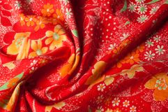 Texture, background, pattern. Cotton cloth of red color, On the. Fabric are painted flowers yellow white Stock Image