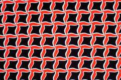 Texture, background, pattern. Fabric drawing of a diamond diamond red on a black background royalty free stock image