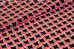 Texture, background, pattern. Fabric drawing of a diamond diamond red on a black background royalty free stock photography
