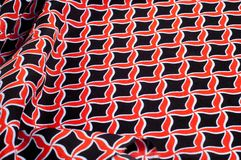 Texture, background, pattern. Fabric drawing of a diamond diamond red on a black background stock photography