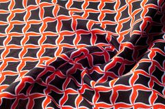 Texture, background, pattern. Fabric drawing of a diamond diamond red on a black background royalty free stock photos