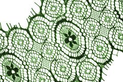 Texture, background, pattern. lace fabric. green. Stunning embroidered flowers bloom on the border along both edges, while. Sporadically grows through the stock photos