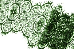 Texture, background, pattern. lace fabric. green. Stunning embroidered flowers bloom on the border along both edges, while. Sporadically grows through the royalty free stock images