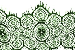 Texture, background, pattern. lace fabric. green. Stunning embroidered flowers bloom on the border along both edges, while. Sporadically grows through the royalty free stock photography