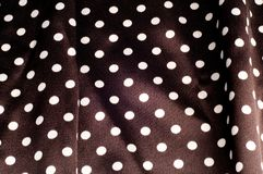 Texture, background, pattern. Tissue silk is brown. Polka dots. Faux Silk CHARMEUSE Satin Fabric Brown & Ivory Oval Polka Dots stock photography