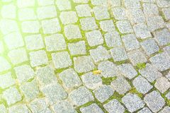 Texture, background. The pavement of granite stone. Paved roadway street. any paved area or surface. Old cobblestone road. Pavement texture, grass between royalty free stock photo