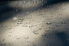 Texture background. raindrops on paintwork. Precipitation in the Stock Photos