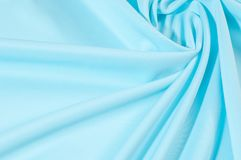 Texture. Background. Template. Pamper your design with a luxurious light blue silk flag. The blue dip can boast of a dull sheen. And a crisp hand. His stiff royalty free stock image