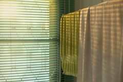 Texture and background of towels hanging on the hanger with light of sunset and shadow stock images