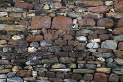 Texture, background wall Laid natural stones of various sizes and colors Stock Photography