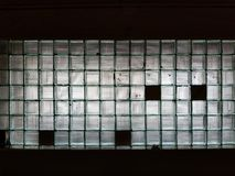 Texture background wall made of many glass cubes with black fields stock image