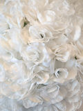 Texture background of white artificial flowers, petals. Background of white artificial flowers, petals Stock Images