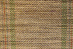 Texture background. Woven straw mat for lying on the beach Royalty Free Stock Images