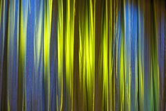 Texture background yellow curtain and shadow of light. Horizontally framed shot Stock Photo