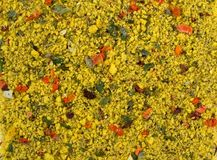Texture background. Yellow spice mix. Spices consist dried dehydrated vegetables. Carrot paprika onion garlic parsnip parsley tomatoes stock images