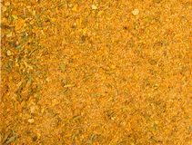 Texture background. Yellow spice mix. Spices consist dried salt garlic onion herbs spices turmeric stock image