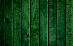 Texture backround design. Bertical long color shapes one near another which together make a green empty wooden-shaped backround royalty free stock photos