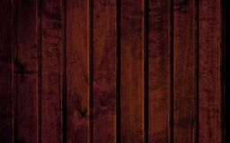 Texture backround design. Vertical long golden brown shapes one near another which make together a golden brown wooden-shaped backround royalty free stock images