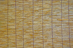 Texture of bamboo brown tablecloth close up. Royalty Free Stock Image