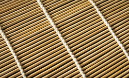 Texture of bamboo mat for sushi. Close-up. Rectangular background. Texture of bamboo mat for sushi. Close-up. Rectangular horizontal background Royalty Free Stock Photography