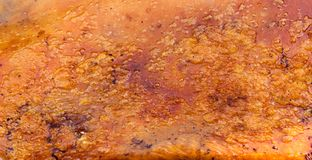 Texture barbecued suckling pig or Roasted suckling pig.  royalty free stock photos