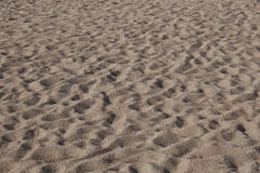 Texture of the beach sand. Sand of the Mediterranean beach. Calella, Spain Royalty Free Stock Images