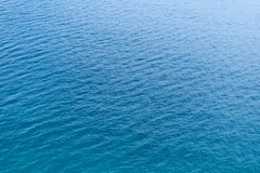 Texture of beautiful azure sea ripples, background stock photos