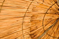 Texture of beautiful straw natural sun umbrellas from hay with patterns in a tropical desert resort, rest. The background.  Royalty Free Stock Photography