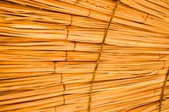 Texture of beautiful straw natural sun umbrellas from hay in a tropical desert resort, rest. The background.  royalty free stock image