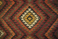 Texture of bedouin traditional wool carpet with geometric patter. N ,Jordan royalty free stock photo