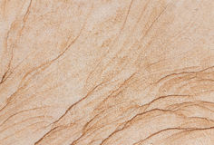 Texture of a beige and brown stone slab Royalty Free Stock Images
