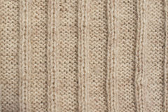 Texture of beige knitted wool sweater with ornament Royalty Free Stock Photo