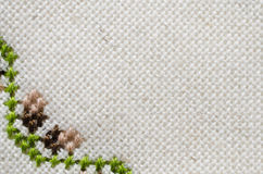 Texture of Beige Linen Fabric with Embroidery. Handmade Embroidery by Cross Stitch in the View of Acorns. Texture of Beige Natural Linen Fabric with Embroidery Royalty Free Stock Photos