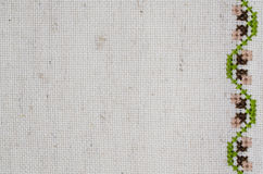 Texture of Beige Linen Fabric with Embroidery. Handmade Embroidery by Cross Stitch in the View of Acorns. Texture of Beige Natural Linen Fabric with Embroidery Stock Images