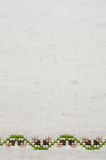 Texture of Beige Linen Fabric with Embroidery. Stock Photography