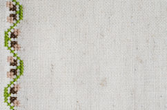 Texture of Beige Linen Fabric with Embroidery. Royalty Free Stock Photography