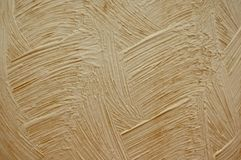 Texture of beige plaster. Texture may be used as background Stock Photos