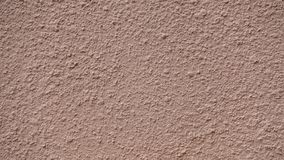 Texture of beige plastered wall for background. stock image