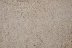 Texture of the beige roughly plastered wall Stock Photos