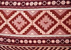 Texture of berber traditional wool carpet, Morocco, Africa. Texture of berber traditional wool carpet with geometric pattern, Morocco, Africa royalty free stock photo