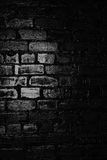 Texture of a black brick wall. Background of black brick texture wall Stock Photos