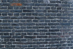 Texture of a black burnt brick wall covered with soot Royalty Free Stock Photos