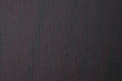 Texture of black cloth with red dots Stock Photo